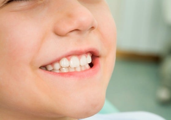 Close-up of little boy smiling at dentist office