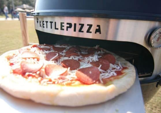Make wood fired pizza at home with the KettlePizza Outdoor Pizza Kit  Made in the USA