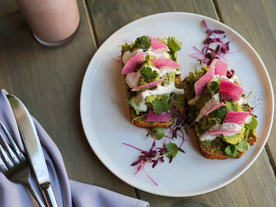Avocado Toast with Watermelon Radish, Cashew Sour Cream, and Micro Greens - Divya's Kitchen - Vegan and Ayuvedic Restaurant in NYC #Ayuvedic #veganeats #avocado #avocadotoast #vegan #nycvegan #veganeats