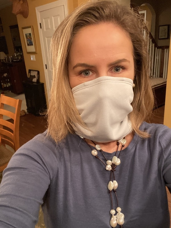 USA Love List founder Sarah Wagner wearing her favorite American made Tuga Sunwear neck gaiter mask (available on Amazon) and West Main Pearls.